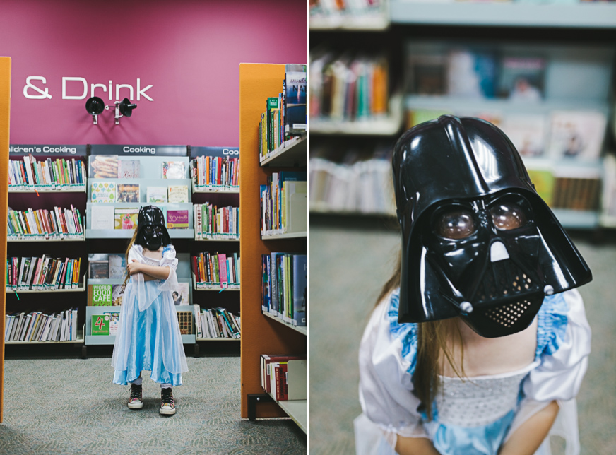 girl dressed as darth vader at the library